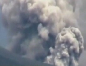 Mount Lokan erupts in Indonesia, spewing ash and rocks thousands of feet into the air.