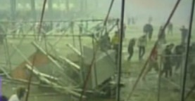 Stage collapses killing 5 in a violent storm at the Pukkelpop Festival in Belgium, canceling the remainder of the three day festival.